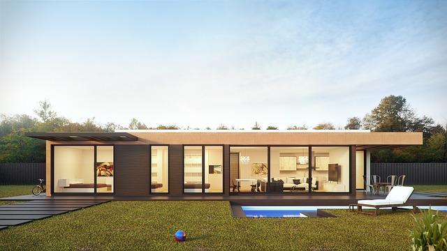 Domček s presklenými stenami a zeleným trávnikom s bazénom